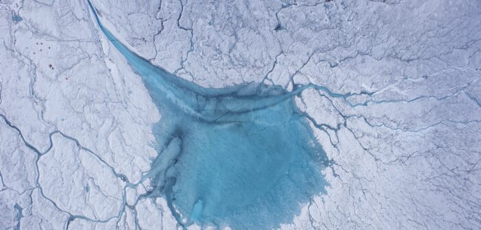 How water under the Greenland ice sheet drives the flow velocities of glaciers